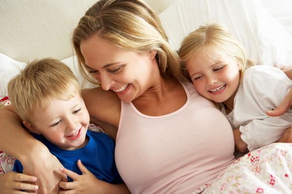 happy-mother-children-hug-a