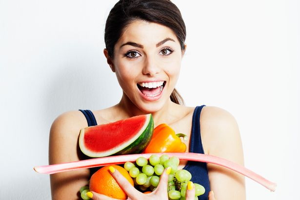 Woman carrying fruit