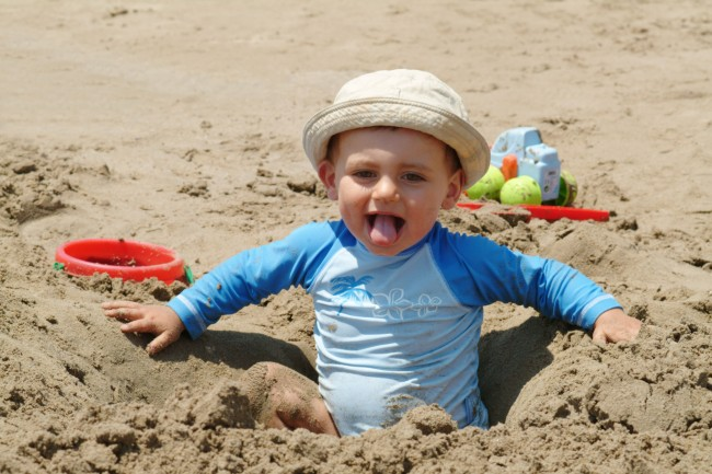 baby-in-hole-in-the-sand