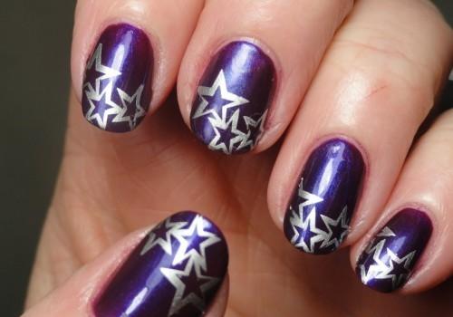 Manicure in a unique purple with silver stars