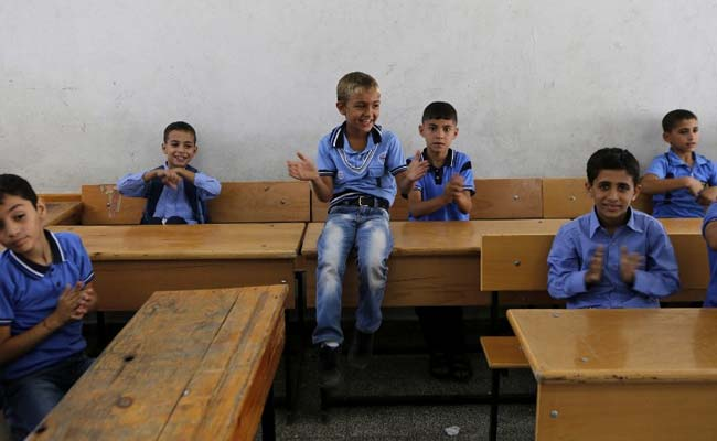 gaza_schools_kids_return_afp_650