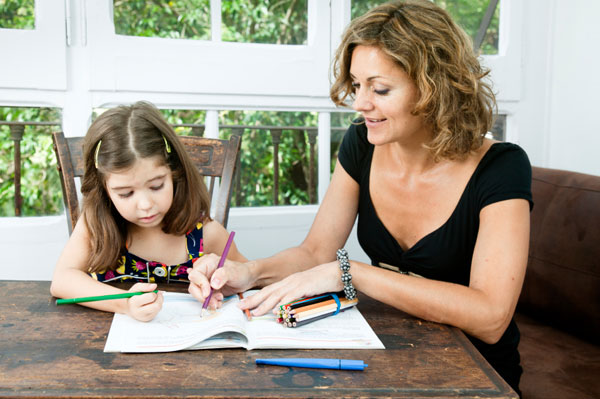 Mother-helping-daughter-with-homework