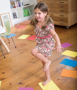 girl-walking-colored-paper-indoor-activities