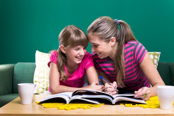 mom-praising-daughter-homework