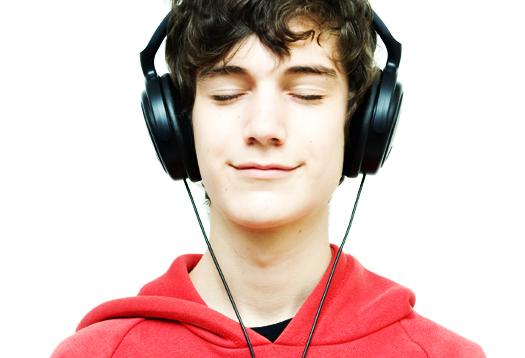 Teenager listening music with headphones