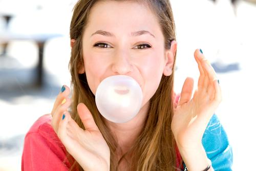 young-girl-blowing-bubble-gum