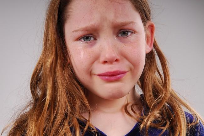 Young-Girl-Crying-and-Upset-25718201