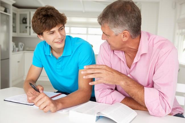 bigstock-Father-helping-teenage-son-wit-23242847