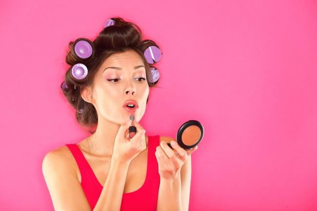 bigstock-Makeup-Woman-Putting-Lipstick-31366397