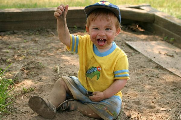 Filthy-and-Loving-It-dirty-child-kid-son-sand-box-weeds-dirt-childhood-happy-thumbs-up-baseball-hat-cute-smile-stick-out-tongue-2-two-front-teeth-smile-bath-time