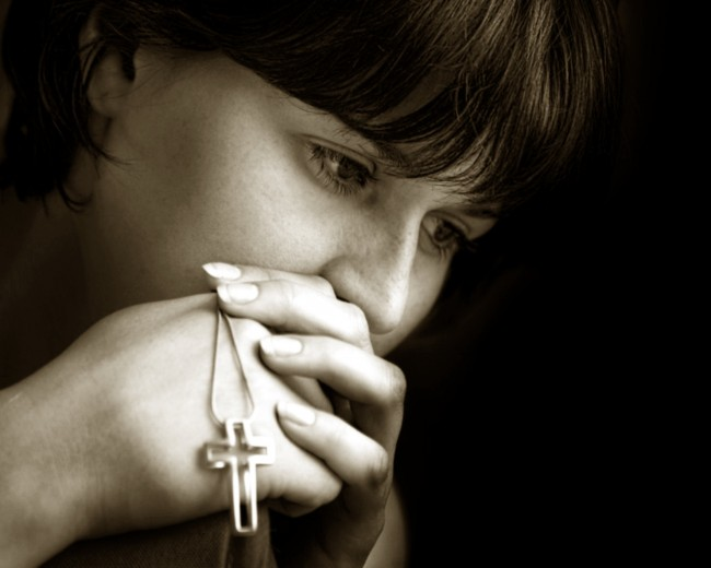 young-woman-praying-and-meditating-sepia