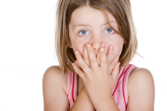 child-hands-over-mouth-