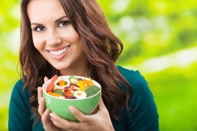 portrait-of-woman-holding-bowl-of-veggies