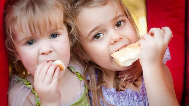 821352-girls-eating-bread