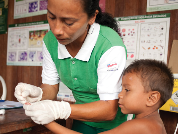 taking blood sample from child