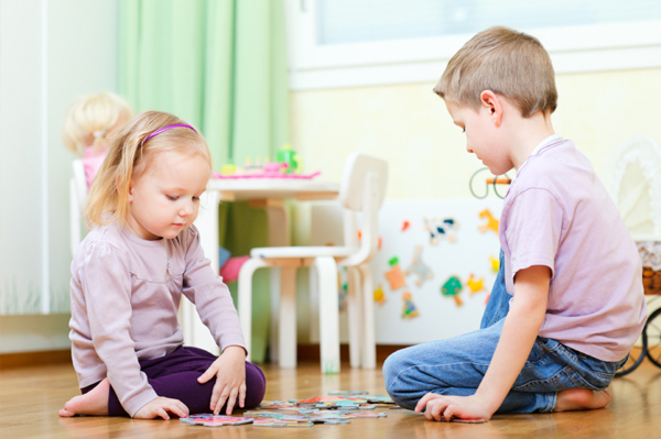 brother-and-sister-playing-with-a-puzzle