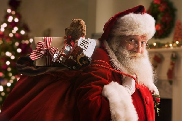 santa-claus-carrying-sack-of-gifts-portrait-close-up